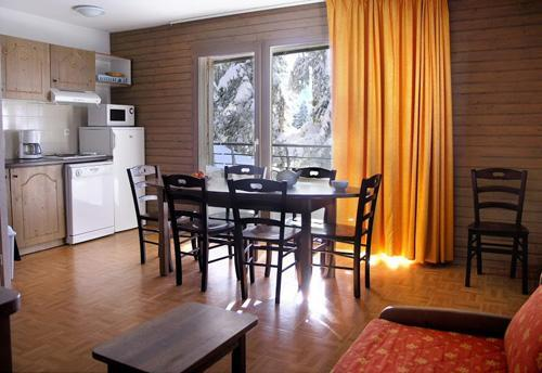 Location au ski Residence L'ecrin Des Neiges - Chamrousse - Coin repas