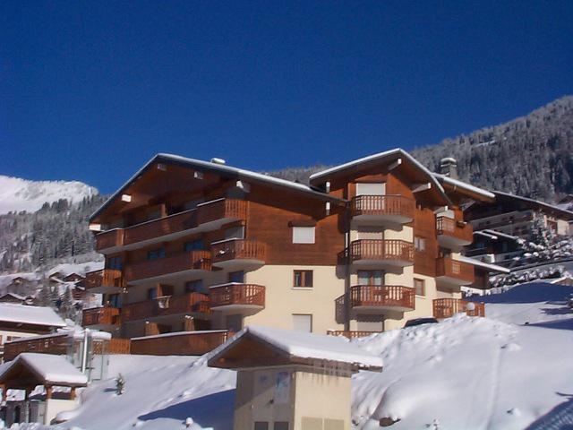 Vacances en montagne Résidence les Jonquilles - Châtel - Extérieur hiver