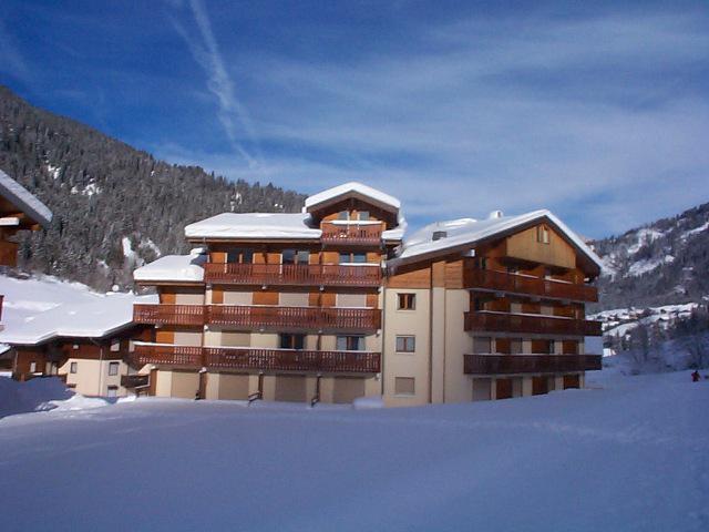 Vakantie in de bergen Résidence les Myrtilles - Châtel - Buiten winter