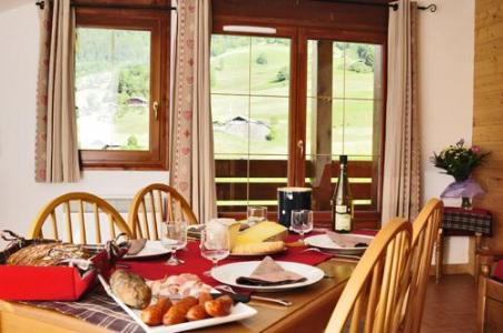Location au ski Residence Les Chalets Des Evettes - Flumet - Coin repas