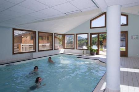 Location au ski Residence Les Chalets Des Evettes - Flumet - Piscine
