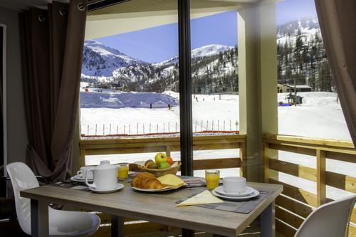 Location au ski Residence Le New Chastillon - Isola 2000 - Coin repas