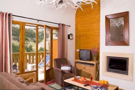 Location au ski Les Chalets Du Diva - Isola 2000 - Cheminée