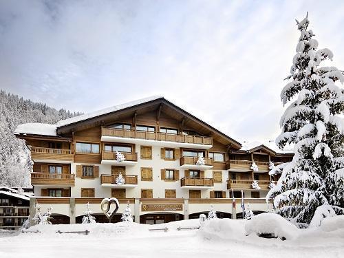 Rent in ski resort Hôtel Au Coeur du Village - La Clusaz - Winter outside