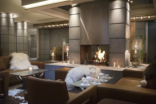 Rent in ski resort Hôtel Au Coeur du Village - La Clusaz - Fireplace