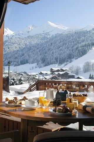 Location au ski Hôtel Carlina - La Clusaz - Extérieur hiver