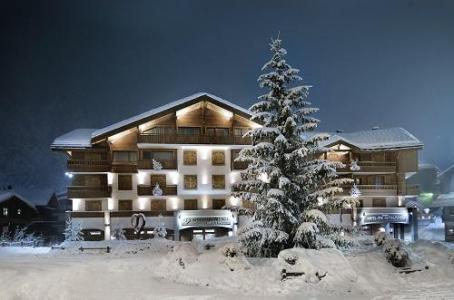 Location au ski Hotel Au Coeur Du Village - La Clusaz - Extérieur hiver