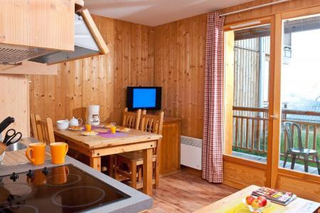 Location au ski Les Chalets du Berger - La Féclaz - Coin repas