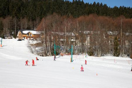 Vacances en montagne Résidence les Balcons d'Aix - La Féclaz - Extérieur hiver