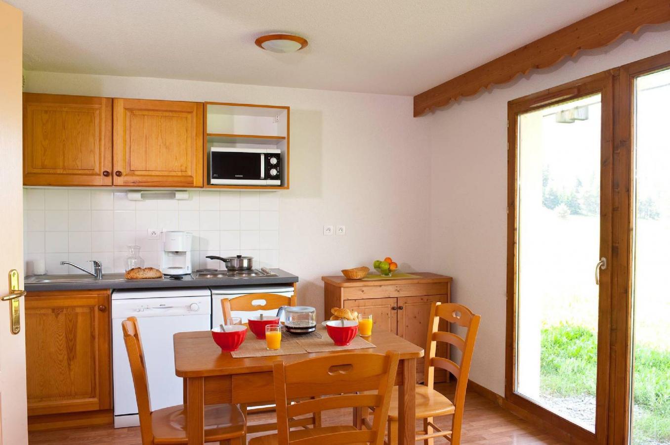 Location au ski Residence La Crete Du Berger - La Joue du Loup - Coin repas