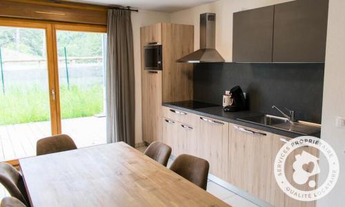Аренда на лыжном курорте Апартаменты 4 комнат 8 чел. (Sélection 73m²) - Résidence les Mélèzes - Maeva Home - La Joue du Loup - зимой под открытым небом