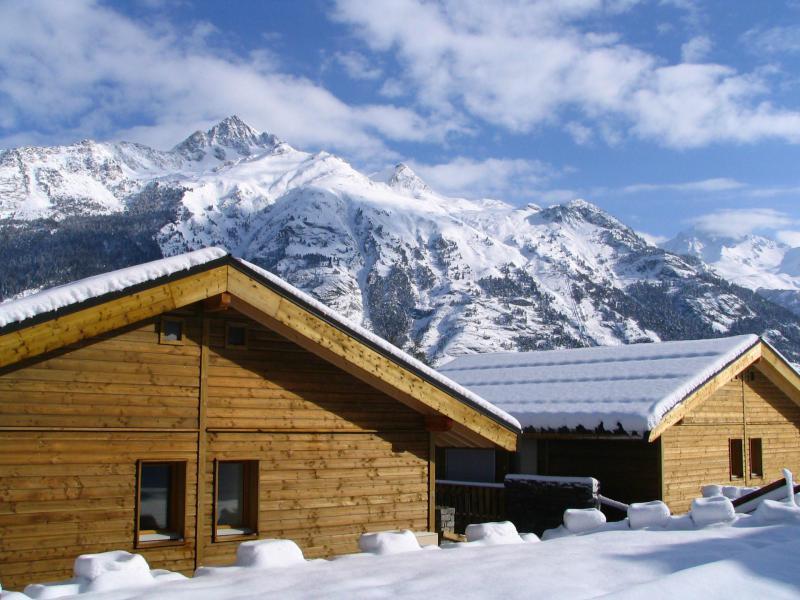 Location au ski Les Chalets Petit Bonheur - La Norma - Extérieur hiver
