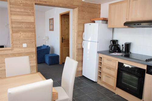 Location au ski Appartement 4-5 pièces 10 personnes - Residence Club Mmv Le Centaure - La Plagne - Coin repas