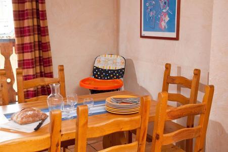 Location au ski Les Lodges des Alpages - La Plagne - Coin repas