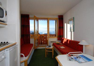 Location au ski Residence La Licorne - La Plagne - Coin repas