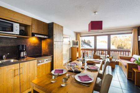 Location au ski Residence Lagrange Les Chalets D'edelweiss - La Plagne - Coin repas