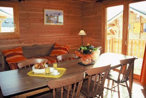 Location au ski Appartement 3 pièces 6 personnes - Les Chalets Goelia - La Toussuire - Coin repas