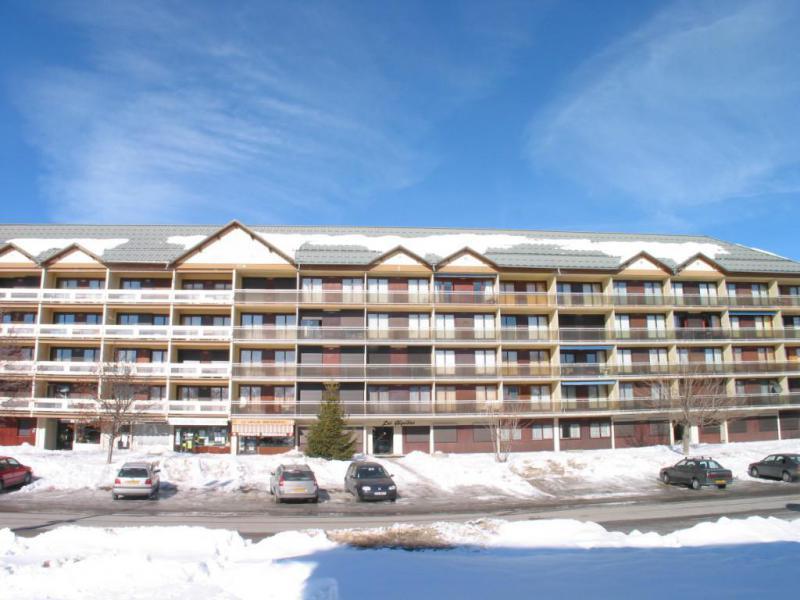 Location au ski Résidence les Aiguilles - La Toussuire - Extérieur hiver