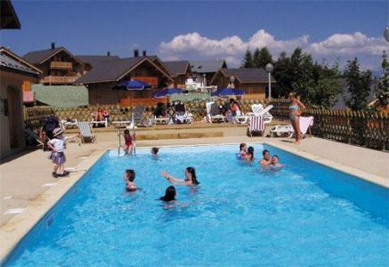 Location au ski Les Chalets Goelia - La Toussuire - Piscine