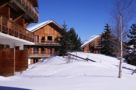 Vacances en montagne Résidence les Chalets des Cimes - La Toussuire - Extérieur hiver