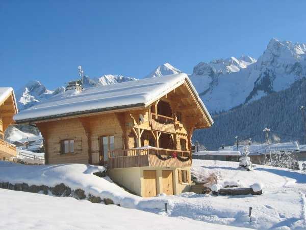 Location au ski Chalet 5 pièces 10 personnes - Residence La Pointe Percee - Le Grand Bornand - Extérieur hiver
