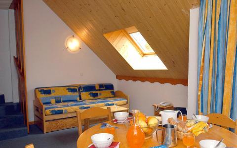 Location au ski Résidences Goelia les Balcons du Soleil - Les 2 Alpes - Coin repas