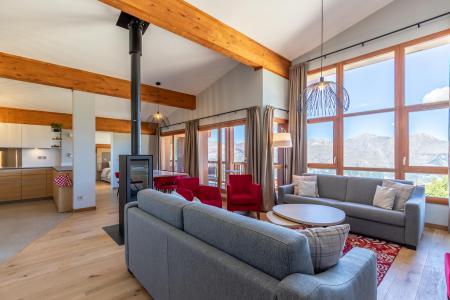 Location au ski Appartement 6 pièces 10 personnes (1000) - Résidence les Monarques - Les Arcs - Poêle à bois