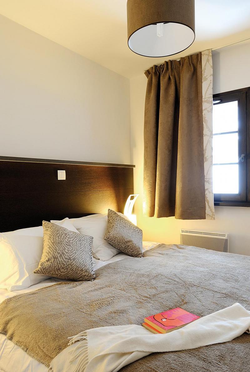 Аренда на лыжном курорте Résidence Lagrange les Fermes d'Emiguy - Les Gets - Двухспальная кровать