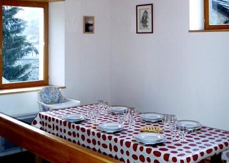 Location au ski Chalet 4 pièces 8 personnes - Chalet Ballade - Les Menuires - Coin repas