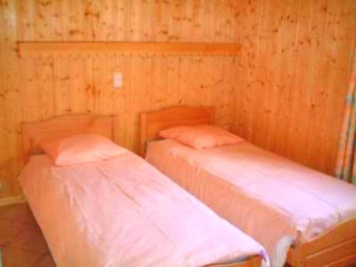 Location au ski Chalet 7 pièces 12 personnes - Chalet Trois Vallees - Les Menuires - Chambre
