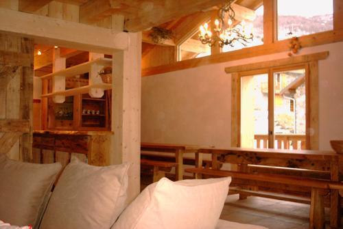 Location au ski Chalet 11 pièces 26 personnes - Chalet Gran Koute - Les Menuires - Coin repas