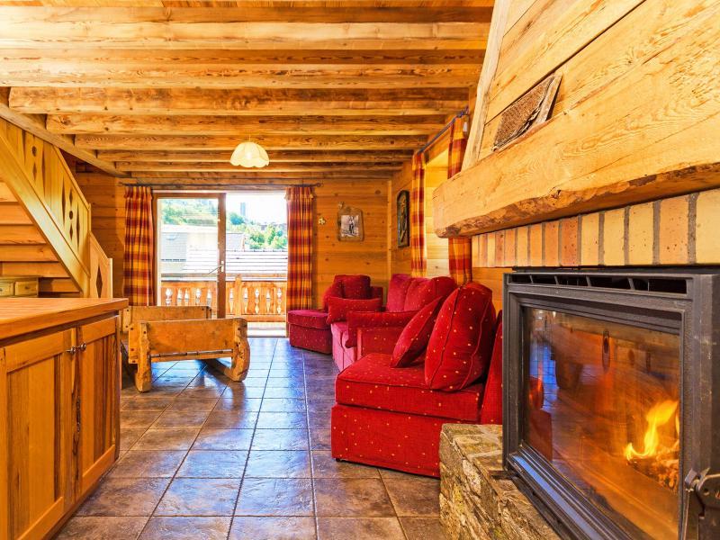 Location au ski Chalet Levassaix - Les Menuires - Cheminée