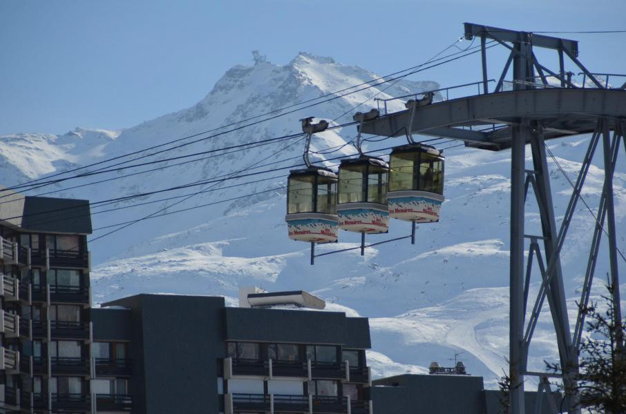 Vacances en montagne La Résidence Caron - Les Menuires - Extérieur hiver