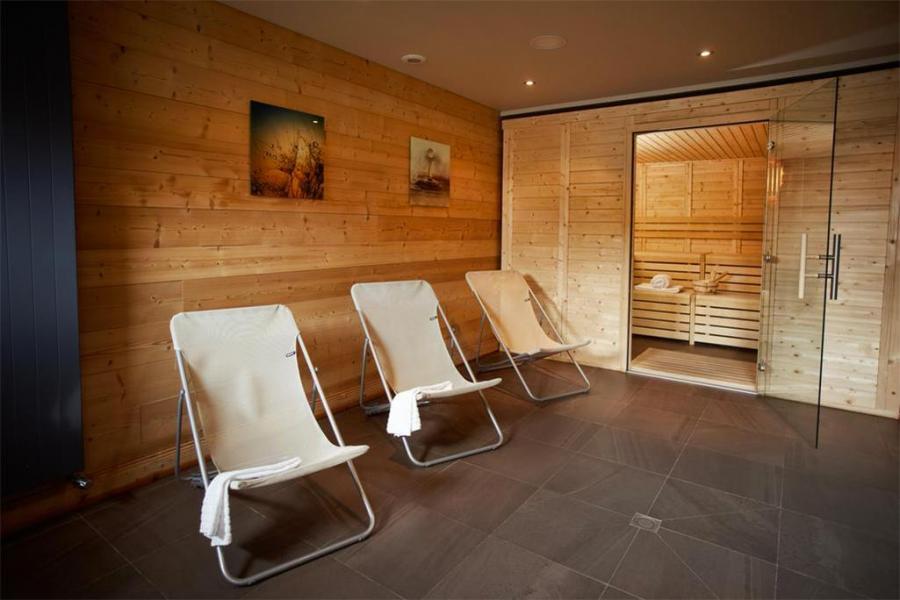 Location au ski Les Chalets Du Soleil Contemporains - Les Menuires - Sauna