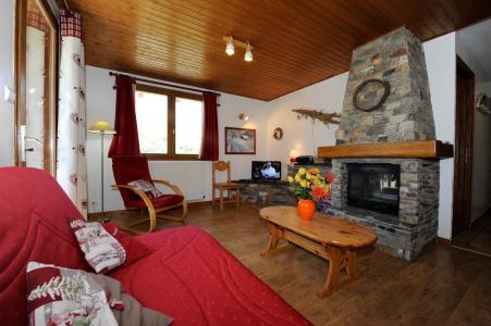 Location au ski Appartement 3 pièces 4-6 personnes - Chalet le Chamois - Les Menuires - Cheminée