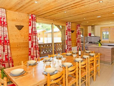 Location au ski Chalet Ski Royal - Les Menuires - Salle à manger