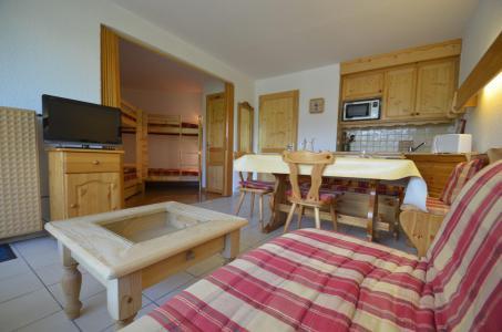 Location au ski Studio coin montagne 5 personnes (714) - La Résidence Chavière - Les Menuires - Canapé