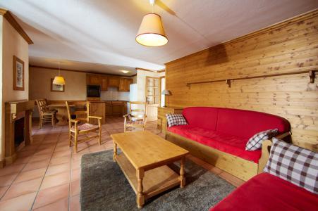 Location au ski Les Chalets du Soleil - Les Menuires - Canapé