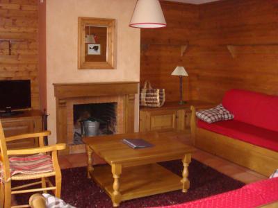 Rent in ski resort Les Chalets du Soleil - Les Menuires - Fireplace
