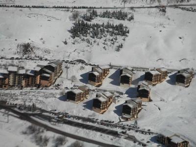 Location au ski Residence Les Asters B4 - Les Menuires - Extérieur hiver