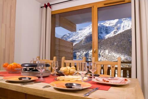 Location au ski Residence Le Balcon Des Airelles - Les Orres - Coin repas