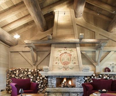 Location au ski Le Hameau du Beaufortain - Les Saisies - Cheminée