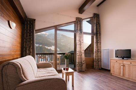 Location au ski Residence Lagrange Les Chalets Du Mont Blanc - Les Saisies - Porte-fenêtre donnant sur balcon