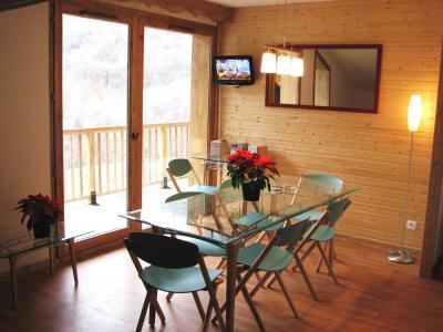 Rent in ski resort Le Hameau des Eaux d'Orelle - Orelle - Dining area