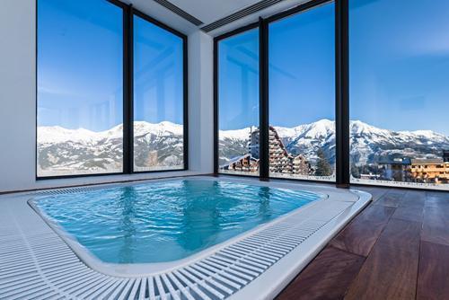 Location au ski Hôtel le Marmotel - Pra Loup - Bain à remous