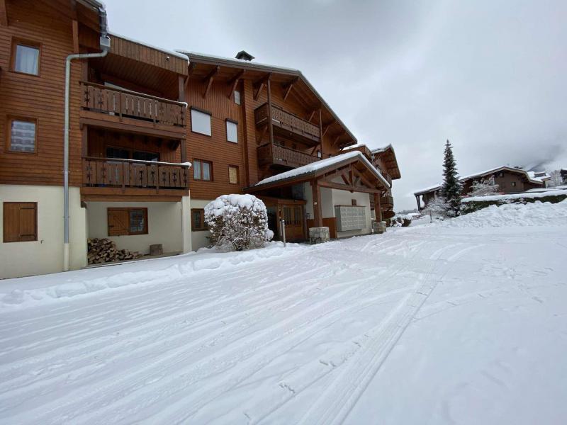 Аренда на лыжном курорте Résidence les Ecrins - Praz sur Arly - зимой под открытым небом