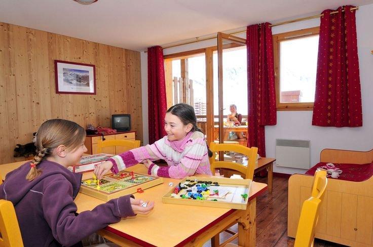 Location au ski Appartement 4 pièces 8 personnes - Residence Les 4 Vallees - Saint-François Longchamp - Coin repas