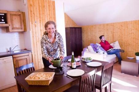 Location au ski Les Chalets Des Ecourts - Saint Jean d'Arves - Coin repas