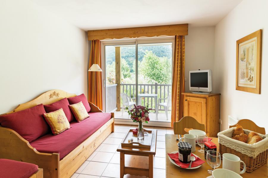 Location au ski Résidence Lagrange l'Ardoisière - Saint Lary Soulan - Coin séjour