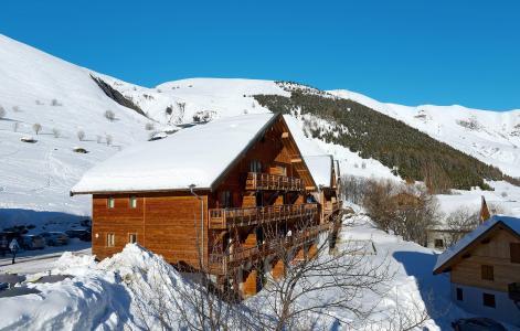 Vacances en montagne Résidence les Chalets de la Porte des Saisons - Saint Sorlin d'Arves - Extérieur hiver